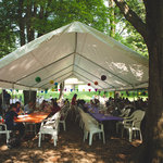 Everyone enjoys a good cookout under the picnic grove tents.