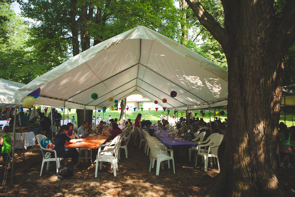 & Everyone enjoys a good cookout under the picnic grove tents.